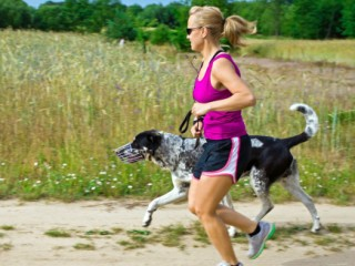 Woman running and walking a dog
